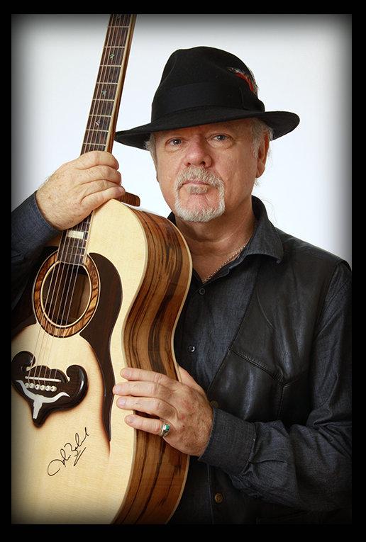 John Beland holding Guitar